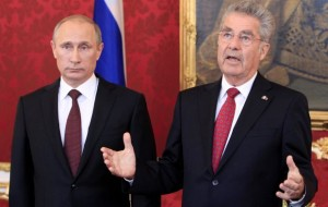 Austrian President Heinz Fischer talks to the media as he arrives with Russian Presdent Vladimir Putin in the presidential office in Vienna