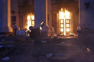 A protester throws a petrol bomb at the trade union building in Odessa