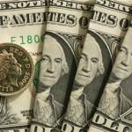 Курс доллара растет на мировых рынках