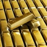 Золото дешевеет на фоне укрепления доллара и новостей из ФРС